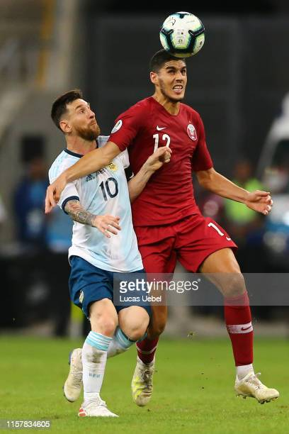 Lionel Messi of Argentina fights for the ball with Karim Boudiaf of Qatar during the Copa America Brazil 2019 group B match between Qatar and...