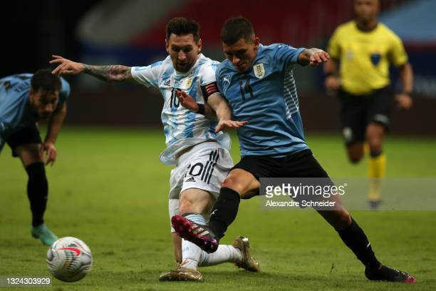 Lionel Messi of Argentina fights for the ball with Lucas Torreira of Uruguay during a group A match between Argentina and Chile as part of Conmebol...