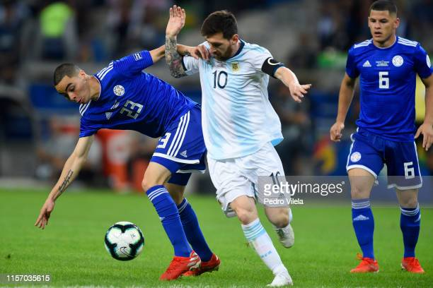 Lionel Messi of Argentina fights for the ball with Miguel Almiron of Paraguay during the Copa America Brazil 2019 group B match between Argentina and...