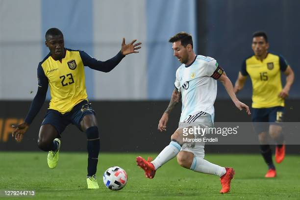 Lionel Messi of Argentina fights for the ball with Moises Caicedo of Ecuador during a match between Argentina and Ecuador as part of South American...