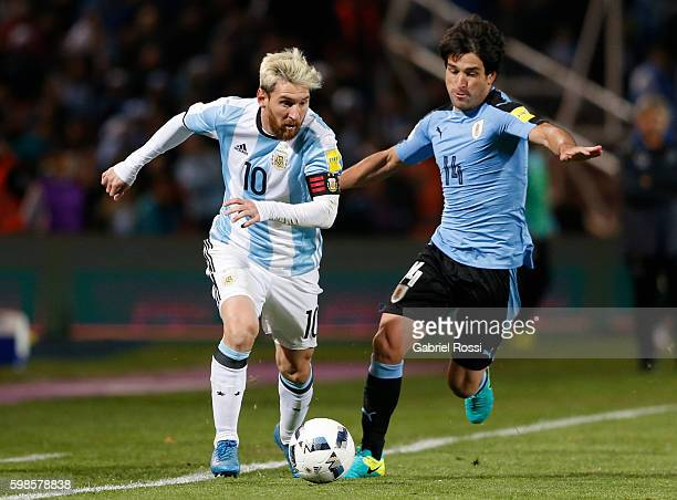 Lionel Messi of Argentina fights for the ball with Nicolas Lodeiro of Uruguay during a match between Argentina and Uruguay as part of FIFA 2018 World...