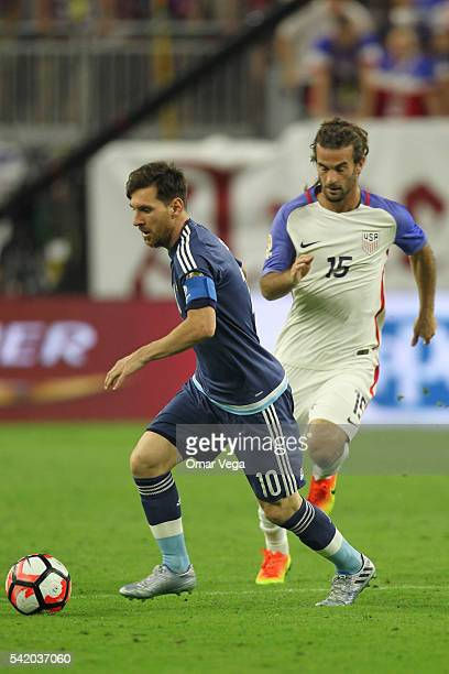 Lionel Messi of Argentina fights for the ball with Perry Kitchen of United States during the Semifinal match between United States and Argentina at...
