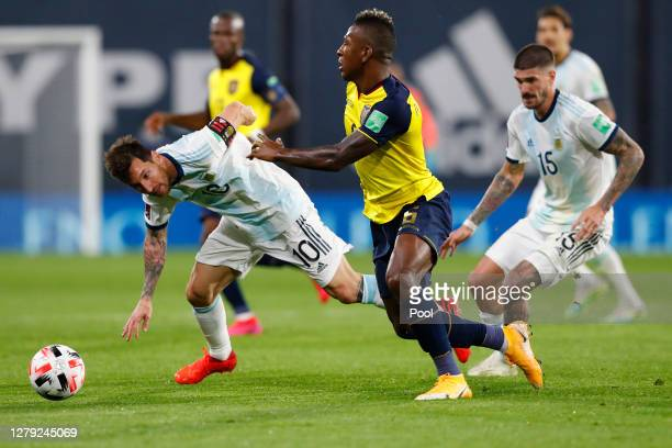 Lionel Messi of Argentina fights for the ball with Pervis Estupiñán of Ecuador during a match between Argentina and Ecuador as part of South American...