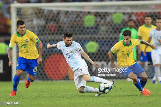 Lionel Messi of Argentina fights for the ball with Philippe Coutinho of Brazil during the Copa America Brazil 2019 Semi Final match between Brazil...