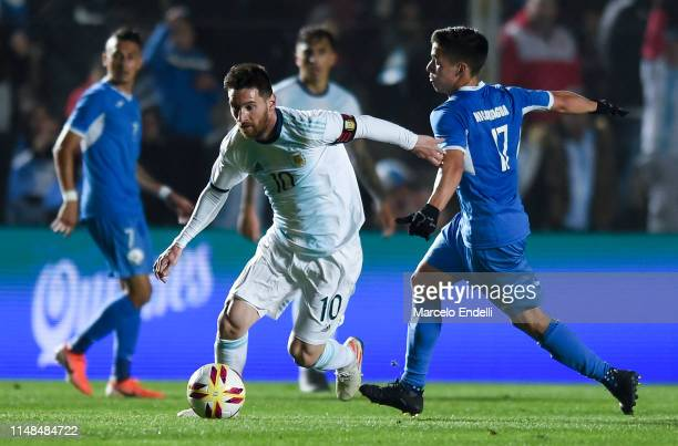 Lionel Messi of Argentina fights for the ball with Renato Punyed of Nicaragua during a friendly match between Argentina and Nicaragua at Estadio San...
