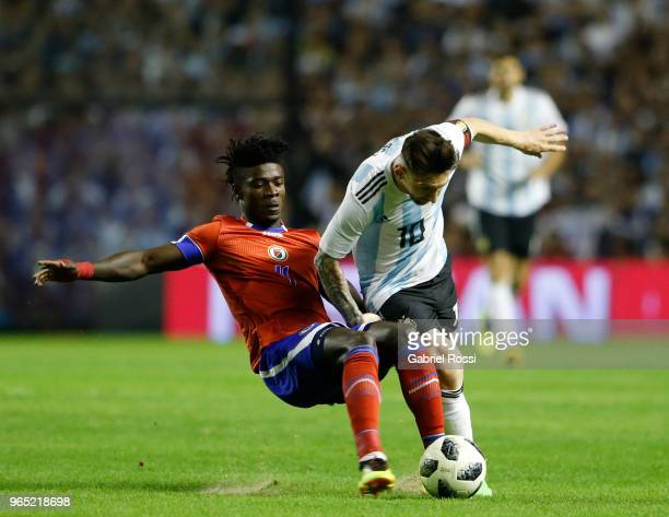 Lionel Messi of Argentina fights for the ball with Ricardo Ade of Haiti during an international friendly match between Argentina and Haiti at Alberto...