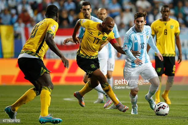 Lionel Messi of Argentina fights for the ball with Rodolph Austin of Jamaica during the 2015 Copa America Chile Group B match between Argentina and...