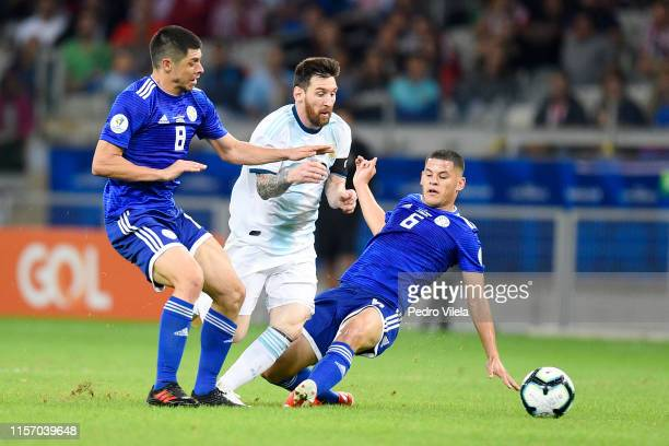 Lionel Messi of Argentina fights for the ball with Rodrigo Rojas and Richard Sanchez of Paraguay during the Copa America Brazil 2019 group B match...