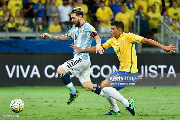 Lionel Messi of Argentina fights for the ball with Thiago Silva of Brazil during a match between Argentina and Brazil as part of FIFA 2018 World Cup...