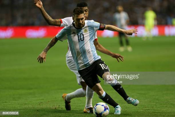 Lionel Messi of Argentina fights for the ball with Wilder Cartagena of Peru during a match between Argentina and Peru as part of FIFA 2018 World Cup...