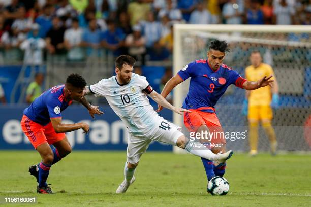 Lionel Messi of Argentina fights for the ball with Wílmar Barrios and Radamel Falcao of Colombia during the Copa America Brazil 2019 group B match...