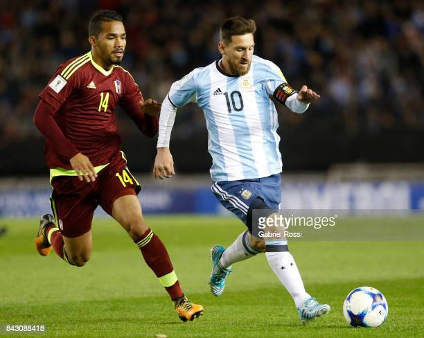 Lionel Messi of Argentina fights for the ball with Yangel Herrera of Venezuela during a match between Argentina and Venezuela as part of FIFA 2018...