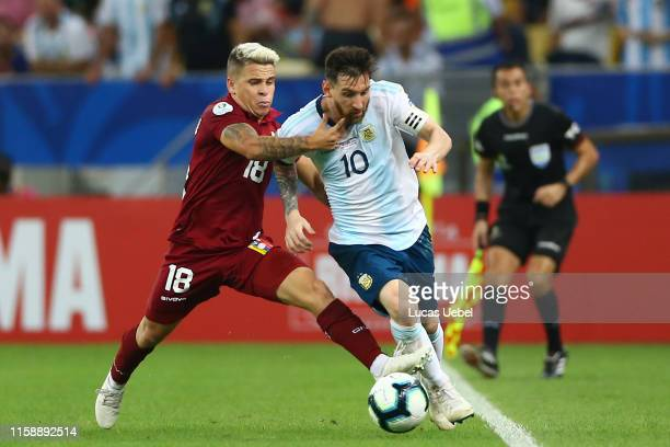 Lionel Messi of Argentina fights for the ball with Yeferson Soteldo of Venezuela during the Copa America Brazil 2019 quarterfinal match between...