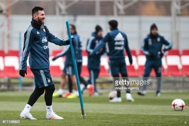 Lionel Messi of Argentina gestures as he carries a plastic soccer stick during a training session at Spartak Stadium on November 7 2017 in Moscow...