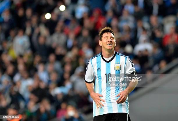 Lionel Messi of Argentina gestures during a FIFA friendly match between Argentina and Slovenia at Ciudad de La Plata Stadium on June 7 2014 in La...