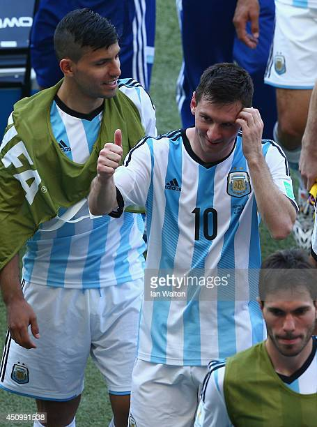 Lionel Messi of Argentina gestures while walking off the field with teammates after defeating Iran 10 during the 2014 FIFA World Cup Brazil Group F...