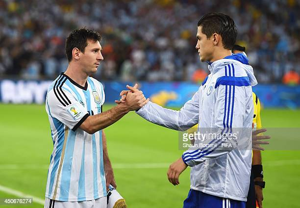 Lionel Messi of Argentina greets Muhamed Besic of Bosnia and Herzegovina prior to the 2014 FIFA World Cup Brazil Group F match between Argentina and...