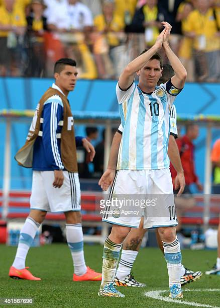 Lionel Messi of Argentina greets supporters at the end of the 2014 FIFA World Cup Round of 16 soccer match between Argentina and Switzerland at Arena...