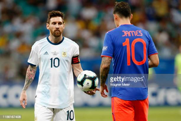 Lionel Messi of Argentina handles the ball with James Rodriguez of Colombia during the Copa America Brazil 2019 group B match between Argentina and...