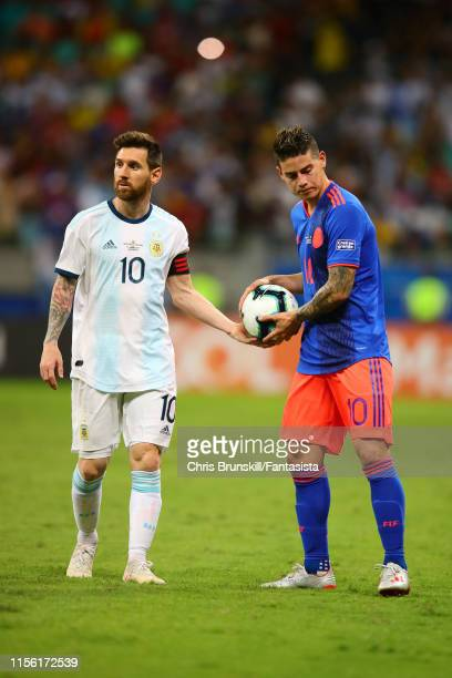 Lionel Messi of Argentina hands the ball to James Rodriguez of Colombia during the Copa America Brazil 2019 group B match between Argentina and...