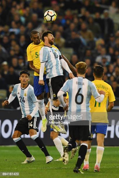 Lionel Messi of Argentina heads the ball from Fernando Roza of Brazil during the Brasil Global Tour match between Brazil and Argentina at Melbourne...