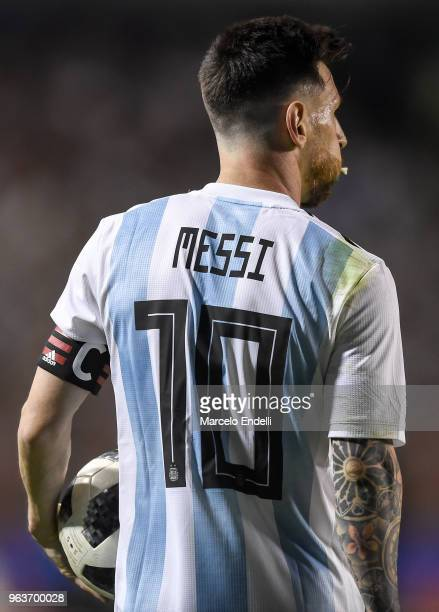 Lionel Messi of Argentina holds the ball during an international friendly match between Argentina and Haiti at Alberto J Armando Stadium on May 29...