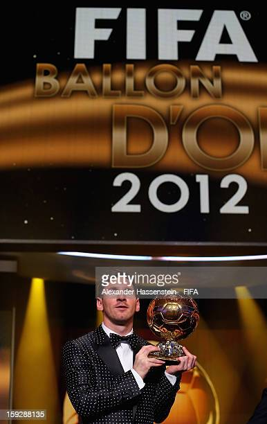 Lionel Messi of Argentina holds the trophy alloft after winning the FIFA Ballon d'Or for a fourth consecutive time during FIFA Ballon d'Or Gala 2012...