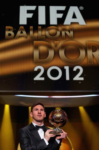 Lionel Messi Of Argentina Holds The Trophy Alloft After Winning FIFA Ballon DOr