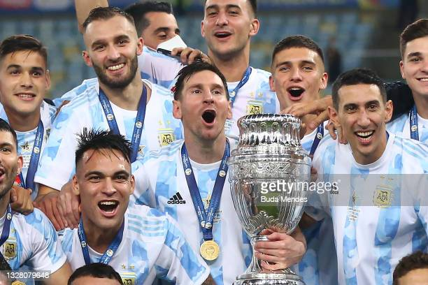 Lionel Messi of Argentina holds the trophy with teammates after winning the final of Copa America Brazil 2021 between Brazil and Argentina at...