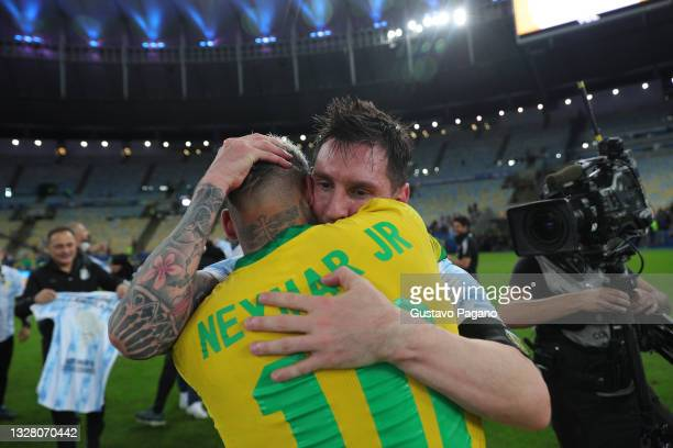 Lionel Messi of Argentina hugs Neymar Jr. Of Brazil after the final of Copa America Brazil 2021 between Brazil and Argentina at Maracana Stadium on...