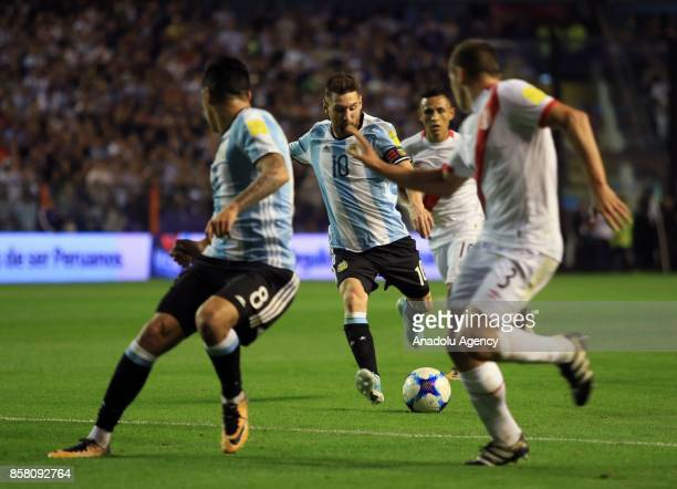 Lionel Messi of Argentina in action against Aldo Corzo of Peru during the 2018 FIFA World Cup Qualification match between Argentina and Peru at the...