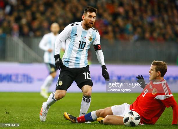 Lionel Messi of Argentina in action against Alexander Kokorin of Russia during the international friendly match between Russia and Argentina at BSA...