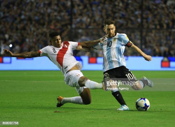 Lionel Messi of Argentina in action against Wilder Cartagena of Peru during the 2018 FIFA World Cup Qualification match between Argentina and Peru at...
