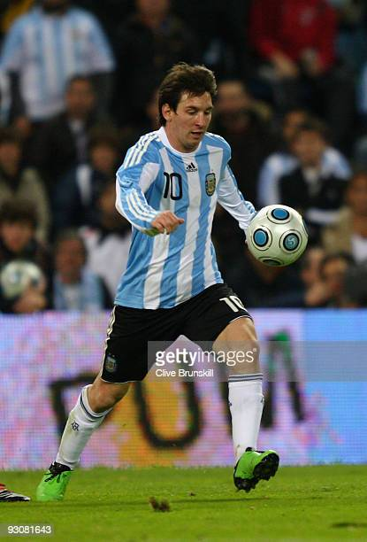 Lionel Messi of Argentina in action during the friendly International football match Spain against Argentina at the Vicente Calderon stadium in...