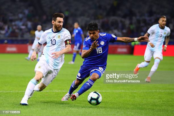 Lionel Messi of Argentina in action with Richard Ortiz of Paraguay during the Copa America Brazil 2019 group B match between Argentina and Paraguay...