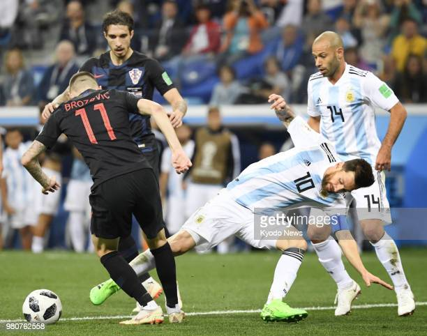 Lionel Messi of Argentina is blocked by Marcelo Brozovic of Croatia during the second half of a World Cup group stage match in Nizhny Novgorod Russia...