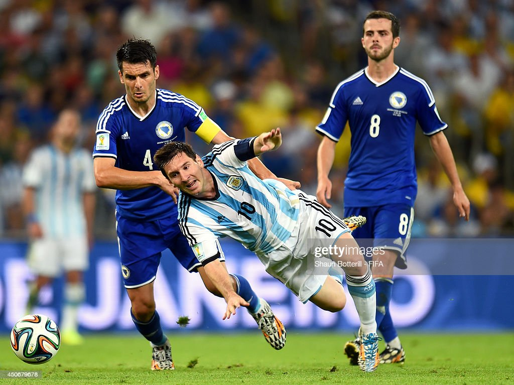 Lionel Messi of Argentina is brought down by Emir Spahic of Bosnia and Herzegovina during the 2014 FIFA World Cup Brazil Group F match between Argentina and Bosnia-Herzegovina at Maracana on June 15, 2014 in Rio de Janeiro, Brazil.