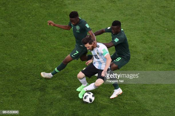 Lionel Messi of Argentina is challenged by Ahmed Musa and Oghenekaro Etebo of Nigeria during the 2018 FIFA World Cup Russia group D match between...