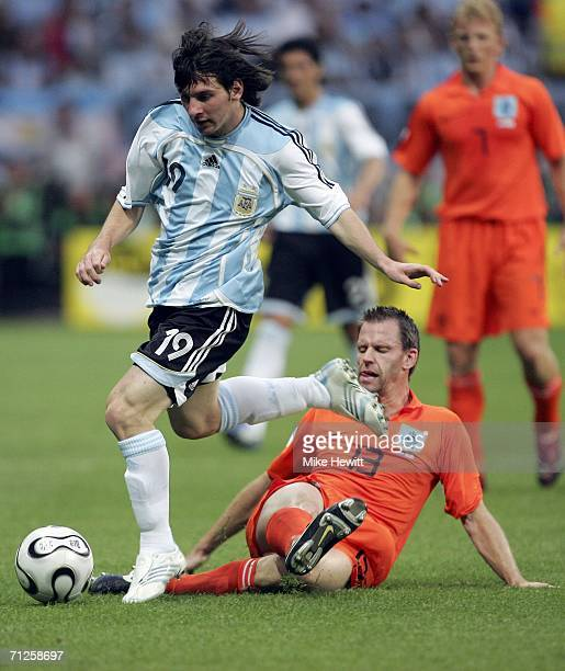 Lionel Messi of Argentina is challenged by Andre Ooijer of the Netherlands during the FIFA World Cup Germany 2006 Group C match between Netherlands...