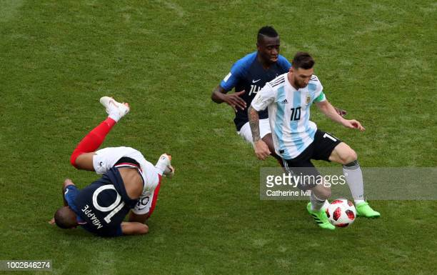 Lionel Messi of Argentina is challenged by Blaise Matuidi and Kylian Mbappe of France during the 2018 FIFA World Cup Russia Round of 16 match between...