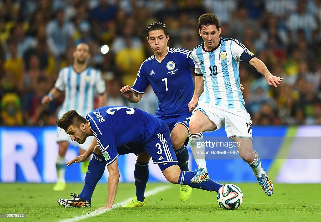 Lionel Messi of Argentina is challenged by Ermin Bicakcic of Bosnia and Herzegovina during the 2014 FIFA World Cup Brazil Group F match between Argentina and Bosnia-Herzegovina at Maracana on June 15, 2014 in Rio de Janeiro, Brazil.