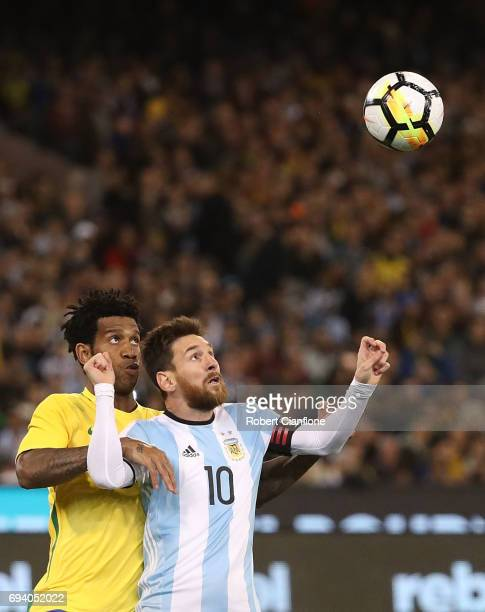 Lionel Messi of Argentina is challenged by Gil SIlva of Brazil during the Brazil Global Tour match between Brazil and Argentina at Melbourne Cricket...