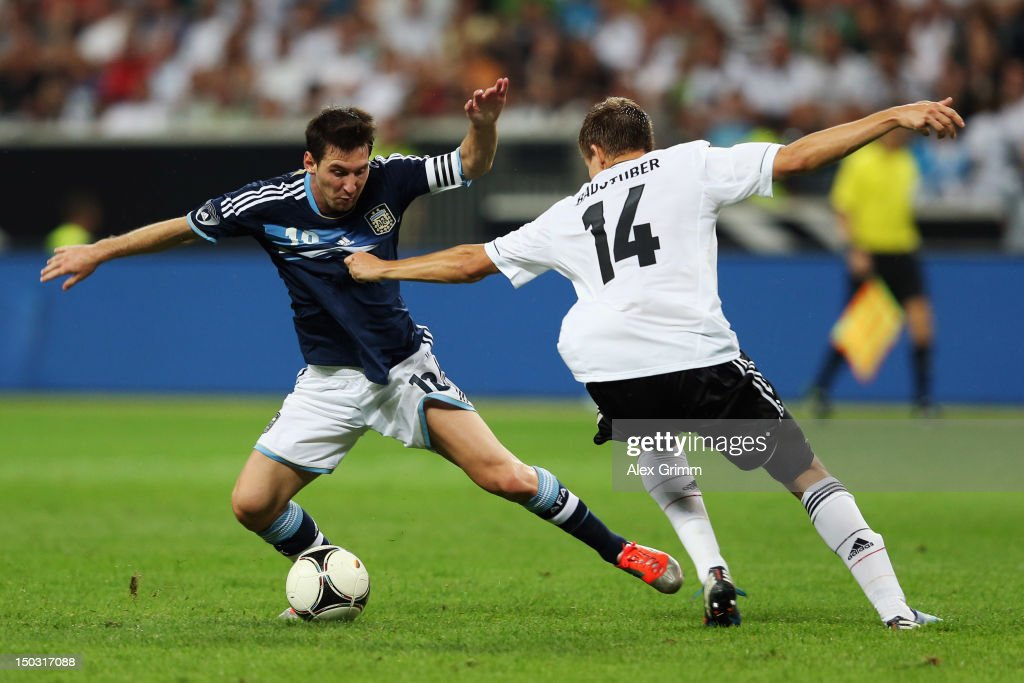Lionel Messi (L) of Argentina is challenged by Holger Badstuber of Germany during the international friendly match between Germany and Argentina at Commerzbank-Arena on August 15, 2012 in Frankfurt am Main, Germany.