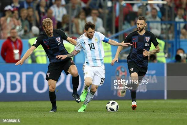 Lionel Messi of Argentina is challenged by Ivan Rakitic and Marcelo Brozovic of Croatia during the 2018 FIFA World Cup Russia group D match between...