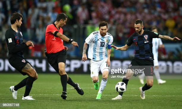 Lionel Messi of Argentina is challenged by Marcelo Brozovic of Croatia during the 2018 FIFA World Cup Russia group D match between Argentina and...
