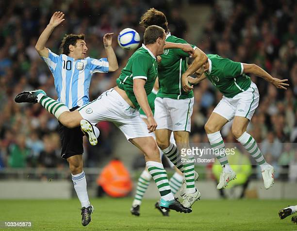 Lionel Messi of Argentina is challenged by the Republic of Ireland defence during the International Friendly match between Republic of Ireland and...