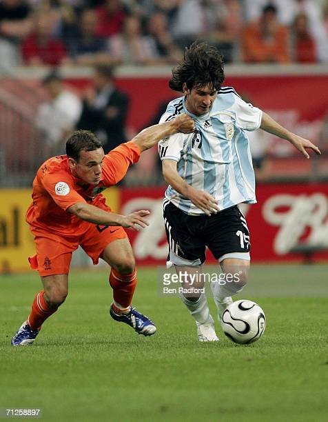 Lionel Messi of Argentina is challenged by Wesley Sneijder of the Netherlands during the FIFA World Cup Germany 2006 Group C match between...