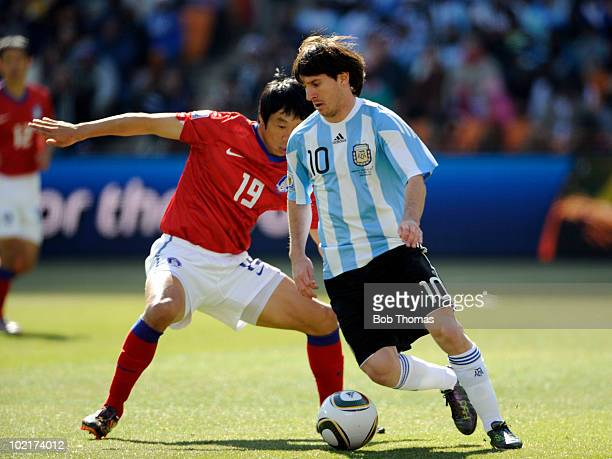 Lionel Messi of Argentina is challenged by Yeom KiHun of South Korea during the 2010 FIFA World Cup South Africa Group B match between Argentina and...