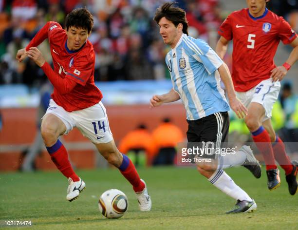 Lionel Messi of Argentina is chased by Lee JungSoo of South Korea during the 2010 FIFA World Cup South Africa Group B match between Argentina and...