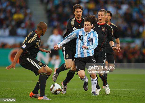 Lionel Messi of Argentina is closed down by Jerome Boateng and Bastian Schweinsteiger of Germany during the 2010 FIFA World Cup South Africa Quarter...